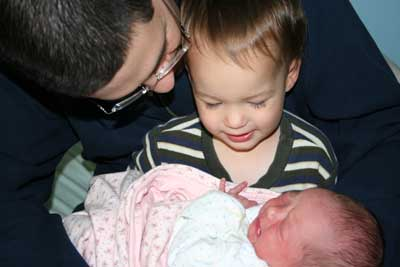 Caden-and-daddy-hold-johanna